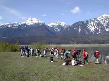 Grade four students birdwatching at Revelstoke Flying Club viewpoint.