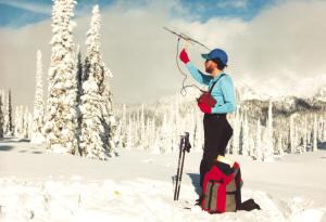 Michael Morris searching for radio-collared caribou on Mount Revelstoke, 1996. Mas Matsushita photo.