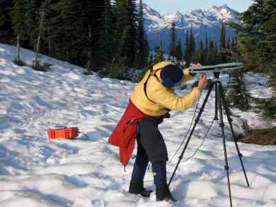 Dr. Jen Theberge, recording bird songs near the summit of Mount Revelstoke, on July 2, 2007. Gregg Walker photo.